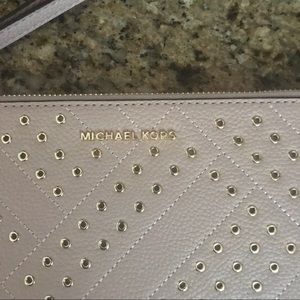 Michael Kors Bags - NWT Michael Kors Large wristlet pink with gold